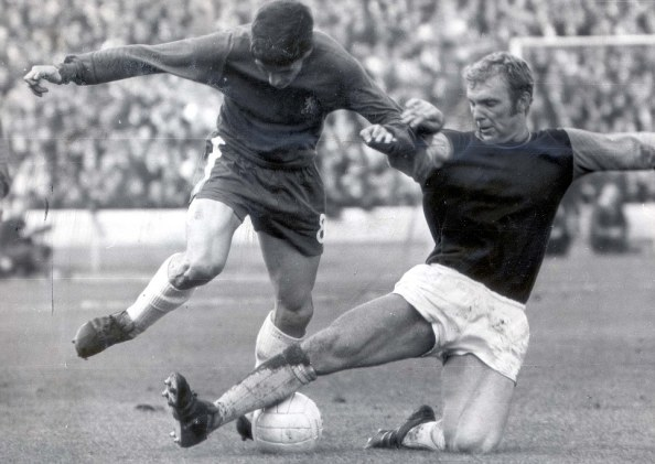 The late, great Bobby Moore doing what he did best