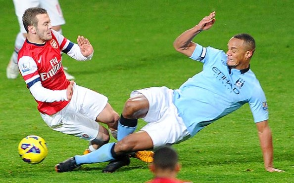 Vincent Kompany tackles on Jack Wilshere which received a red card