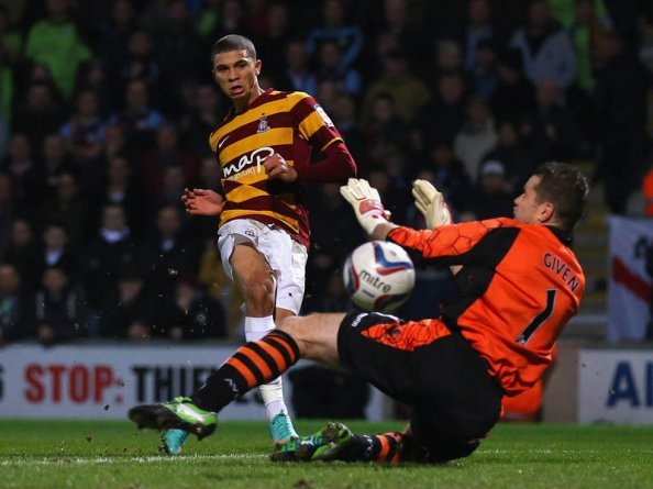Wells slots the ball calmly past Shay Given to give Bradford the lead in the League Cup semi final